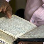 Bible in hands_web